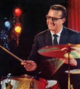 The man behind the solo in classic odd-time jazz hit 'Take Five' has influenced generations of drummers from jazz to rock both as a musician and a gifted drum educator. With the Dave Brubeck Quartet, Joe wasn't going to settle for being the guy at the back without even a spotlight, and his insistence on being a true part of the quartet via his brilliant solos paved the way for the drummer as an equal participant in musical combos since.