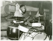 """Drummer in a Memphis """"juke joint"""" orchestra playing a kit with four non-tunable toms. Marion Post Wolcott, October 1939"""