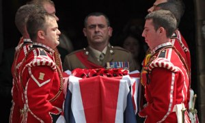 Fusiliers carry the coffin of soldier Lee Rigby out of the Bury parish church after his funeral